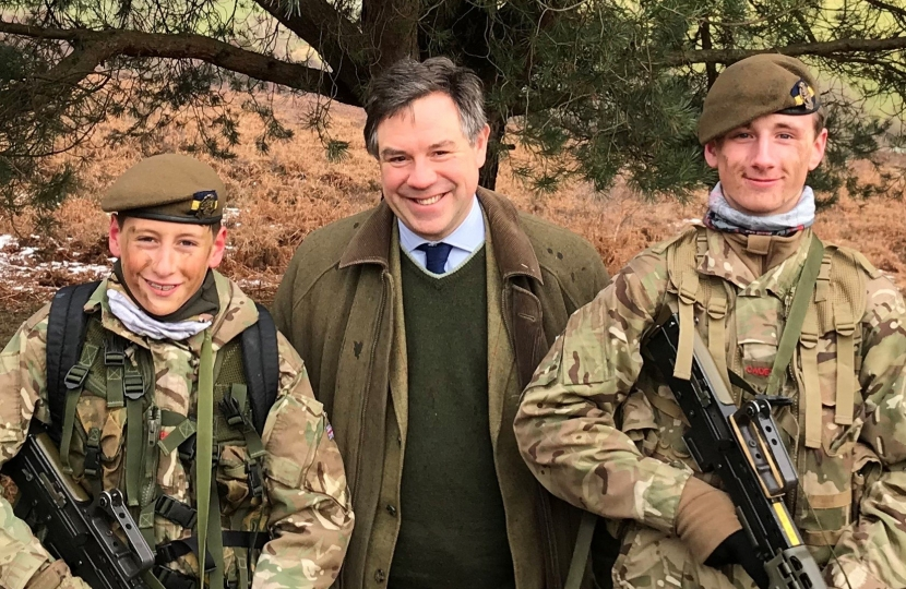 Jeremy Quin with members of the Horsham Army Cadet Force at Crowborough Camp.
