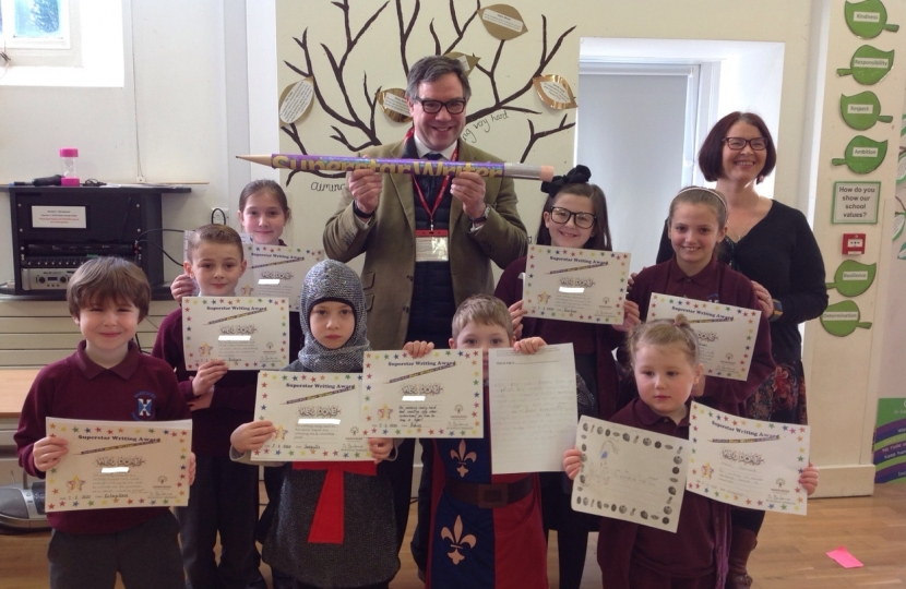 "Jeremy Quin met pupils at Handcross School on Friday (some of whom were dressed for a medieval banquet!) and was delighted to hand out books and certificates including the ""Super Writers"" who had been praised in a national competition."